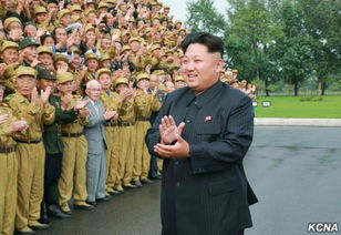 金正恩与全国老兵大会代表合影留念